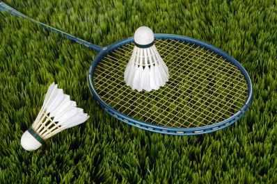 blue badminton racket with shuttlecock